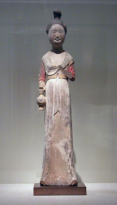 Standing female attendant, Tang dynasty (618-907), late 7th-early 8th century, China