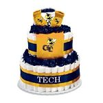"Georgia Tech Yellow Jackets Diaper Cake - The perfect baby shower gift for the collegiate sports fan! These creations are made from layers of diapers, stacked to look like a cake and filled with licensed collegiate baby products (or as we like to call them, ""ingredients""). The standard diaper cake includes two layers of diapers (40-45), a team t-shirt, knit cap and booties.    Cakes may vary in color or ""ingredients"" with available inventory."