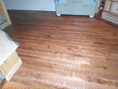 Custom Circle Sawn Hickory with a custom made stain color.  Made by Superior Floors        518-623-2874