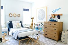 When I designed this kid's coastal bedroom, I was exctied to have it blend with the relaxed vibe of our home. Blues, grays, and warm wood tones!