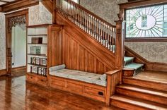 Beautiful staircase with nestled bench. The Potter House, a 1908 Victorian in Harlan, Iowa
