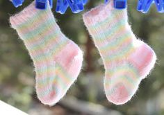 A lovely free knitting pattern for pastel striped baby socks! This pattern  is fairly easy and would be great for a beginner knitter. The finished  socks will make the perfect new baby gift!