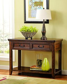 #charity With its oil-rubbed stain accents, rich wood-color stain and antiqued hardware, this sofa table charms #with a rustically refined sensibility. Two front...
