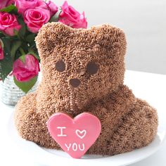 This cake looks just like those adorable stuffed bears sold during Valentine's Day!. Ingredients: 2 cups hot water, 6 tbsp powdered instant coffee,  1 cup cocoa powder, 2 tbsp vanilla extract, 3 cups all-purpose flour,  2 cups sugar,  1 ½ tsp baking soda, 1 tsp salt,  1 cup vegetable oil,  1 ½ cups white chocolate chips, 1 ½ cups butterscotch chips, 4 tsp white vinegar, 2 cups unsalted butter, room temperature, 6-7 cups confectioner's sugar,  1 tsp vanilla extract,  2 tbsp cocoa…