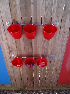 Creating our Childrens' Outdoor Play Area | I like the buckets for the outside of the house.