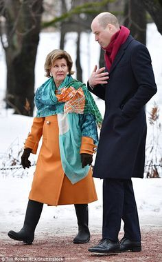The 80-year-old queen consort defied the years in a jaunty orange coat teamed with a patterned green scarf, and looked ready for the icy conditions in a pair of black wellington boots. William also cosied up in a red scarf as he chatted to the queen.