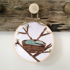spring applique nest and branches with leaf embroidery in hoop
