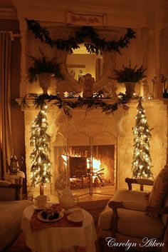 Some of my favorite things...fire in the fireplace, just the glow from the twinkle lights, and tea to sip in a comfy chair!  Love it!