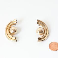 Vintage large mod gold earrings for pierced ears.