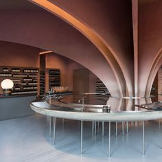 Twelve rose-tinged clay arches fan out over ahuge stainless-steel sink in thisSnøhetta-designedAesop store, designed in tribute toOscar Niemeyer.