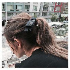 Messy ponytail. Chanel bow. | Source: theepitomeofquiet, via slufoot