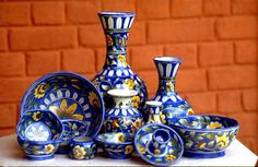 Blue Pottery is a well-recognized art and craft of Jaipur, Rajasthan. Jaipur became the major hub for the blue pottery artists in the century. Indiana, Indian Village, Jodhpur, Decoration Table, Decorations, Pottery Art, Pottery Shop, Pottery Painting, Traditional Art