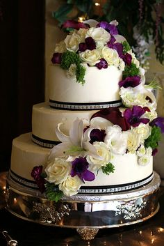 3 layer wedding cake with buttercream and fresh flowers.  Made by All Things Exquisite.