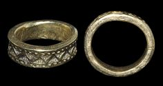 9th-11th century AD. A sturdy Viking period finger ring decorated with offset pellet-in-triangle punchmarks within borders of pellets. Gold, 24.80 grams, 27 mm external diameter (approximate size UK Y, USA 12, Europe 27.51, Japan 26). Very fine condition. Rare.