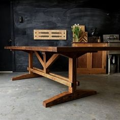 Built from solid reclaimed and rough sawn red oak this farm table commands the attention of the room. Complete with breadboard ends and an elaborate trestle base with pegged details. Sealed with a natural satin clear coat for a lifetime of durability. Dining Table Chandelier, Farm Dining Table, Oak Table, Rustic Table, Wooden Tables, Industrial Chandelier, Tressel Dining Table, Farm Table Diy, Dining Rooms