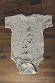 Heather Gray All You Need is Love Screen Printed Infant Onesie Bodysuit