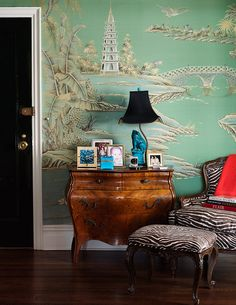 Hand Painted Chinoiserie Wallpaper and a Foo Dog Lamp on an Antique Chest Creates a Lovely Vignette.