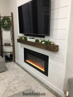 Do you like the look of a wood beam mantle without the cost? You can achieve the look of a rustic beam for less by creating a DIY WOOD BEAM MANTEL Fireplace Accent Walls, Fireplace Tv Wall, Basement Fireplace, Faux Fireplace, Fireplace Remodel, Living Room With Fireplace, Fireplace Design, Electric Fireplace With Mantle, Linear Fireplace