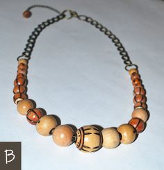 """PALINDROME   To be the same in either direction.  The beauty of this design are the 12 inches of jewelry-grade finished beads—equally descending in size on both sides from the center. The soft, gentle texture of the wood has a calming effect, while the design is strengthened by a double-curb brass chain.   - chain: brass - wood: poplar - length: 24"""" with a 3"""" necklace extender in back  #ecofashion #sustainablefashion #bohojewelry #gypsyjewelry"""
