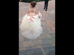 Cute flower girl dress. Big pink bow on the back. Very Princess-like