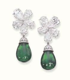 A PAIR OF SUPERB EMERALD AND DIAMOND EAR PENDANTS, BY GRAFF   Each set with a detachable drop-shaped emerald to the marquise and circular-cut diamond cap, suspended from a pear-shaped diamond five-stone cluster top, mounted in platinum, in a Graff black leather case  Signed Graff, no 3160 by abigail