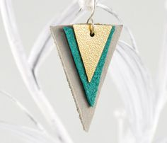 Triangle leather earrings in gray, teal blue and gold. The golden triangle is made of a synthetic material with a charming surface texture, the