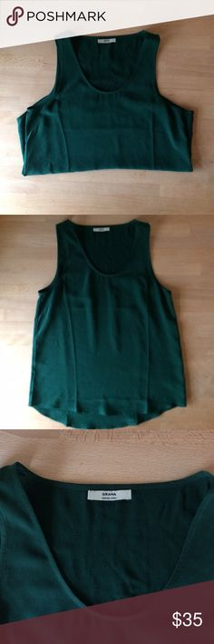 New Grana green silk tank small Everlane New, fits TTS. No tags, Grana ships without tags. This gorgeous emerald green color is sold out. Your go-to basic, no matter what the occasion. Take it to work, to the beach, or out to meet the parents. Just take it out. Crafted from 100% Crepe de Chine Sand-washed to produce a subtle lustre and matte finish 2-ply silk yarn for strength and durability. Look soft, wear hard grana Tops Tank Tops