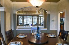 A dining room looking into a great room in a home in Central New York