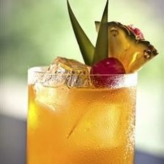 Two flavors of rum combine with pineapple juice and orange juice to make a yummy, fruity drink.