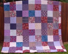 "Quiltville: use 10.5"" squares of lesser-loved fabrics to make a monochromatic backing. use em up!"