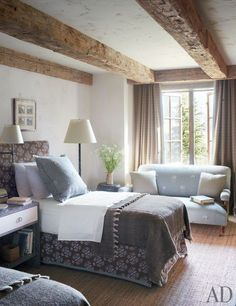 Country bedroom with beams | Markham Roberts