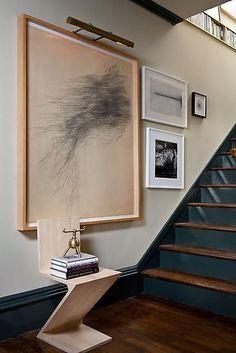 Brown Design Group | Interior Design | Los Angeles + Santa Barbara / painted stairs / statement art gallery wall