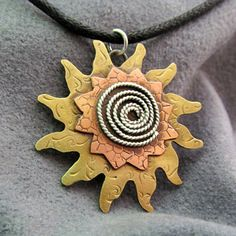 Hand Forged Metal Starburst Pendant  by DeMoyJewelryDesigns