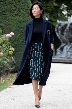 Loving this navy blue printed midi-skirt with a blue trench coat! Click to shop our edit!
