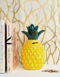 An approp money box to help save up for an island vacation.   29 Gifts For People Who Love Pineapples