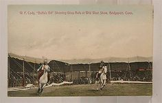 C. 1907 - 1914 postcard of Buffalo Bill's Wild West Arena action scene with Buffalo Bill Cody himself performing his famous trick shooting of glass balls thrown in the air by Native American performer as both men gallop around the arena before a crowd of spectators in Bridgeport, Conn.  s*c