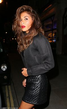 Don't Cha? We do! The 36-year-old stunned in a chic ensemble made up of a quilted leather skirt