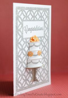 This 3-D handmade wedding card is full of silver glitter and yellow flowers.