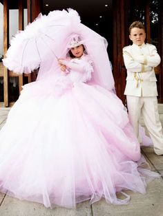 Oh, the extravaganza! This is a little girl's dress for her 1st Communion