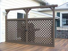 Custom cedar deck privacy divider with lattice.