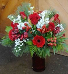 Red & White Holiday Flowers by Montgomery Florist, Montgomery NY    See more - Florist Friday Recap 12/08 – 12/14: Christmas Traditions
