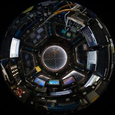 Fish-eye lens attached to an electronic still camera to capture this image of the Cupola