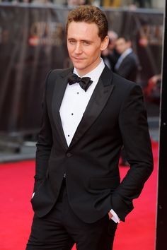 Tom Hiddleston attends the Laurence Olivier Awards at the Royal Opera House on April 13, 2014 in London, England [HQ]