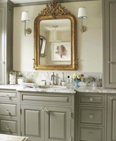 the mix of gold and silver against the gray walls and cabinetry