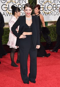 We're not surprised that Lorde wore a pantsuit on the 2015 Golden Globes red carpet but what a pantsuit!On Sunday, the wunderkind sported a black Narciso Rodriguez crop top, wide-legged tr. Lorde, Black Suede Pumps, Trends, Golden Globes, Black Blazers, Black Crop Tops, Looking For Women, Wide Leg Pants, Nice Dresses