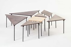 Tangram / Coffee table and a classic tiling game. Every piece of the puzzle is a separate side table. Made from birch plywood in different colours.