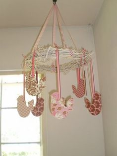 This would have been cute in Ava's nursery. Would have been a lot cheaper to make than the mobile that we bought.