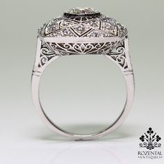 Period: Art deco (1920-1935) Composition: Platinum. Stones: 1 Old mine cut diamond of H-SI1 quality that weighs 1ctw. 40 Old mine cut diamonds of H-VS2 quality