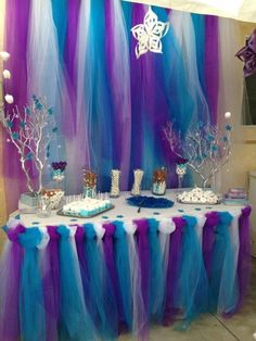 Purple, white, blue, and teal dessert table decoration idea for a winter wonderland or Frozen theme birthday party including silver painted branches and affordable toule DIY backdrop. Frozen Birthday Party, Frozen Theme Party, 4th Birthday Parties, Birthday Party Decorations, Frozen Table Decorations, Birthday Candy, 3rd Birthday, Birthday Ideas, Dessert Table