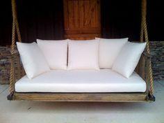 white rustic porch swing